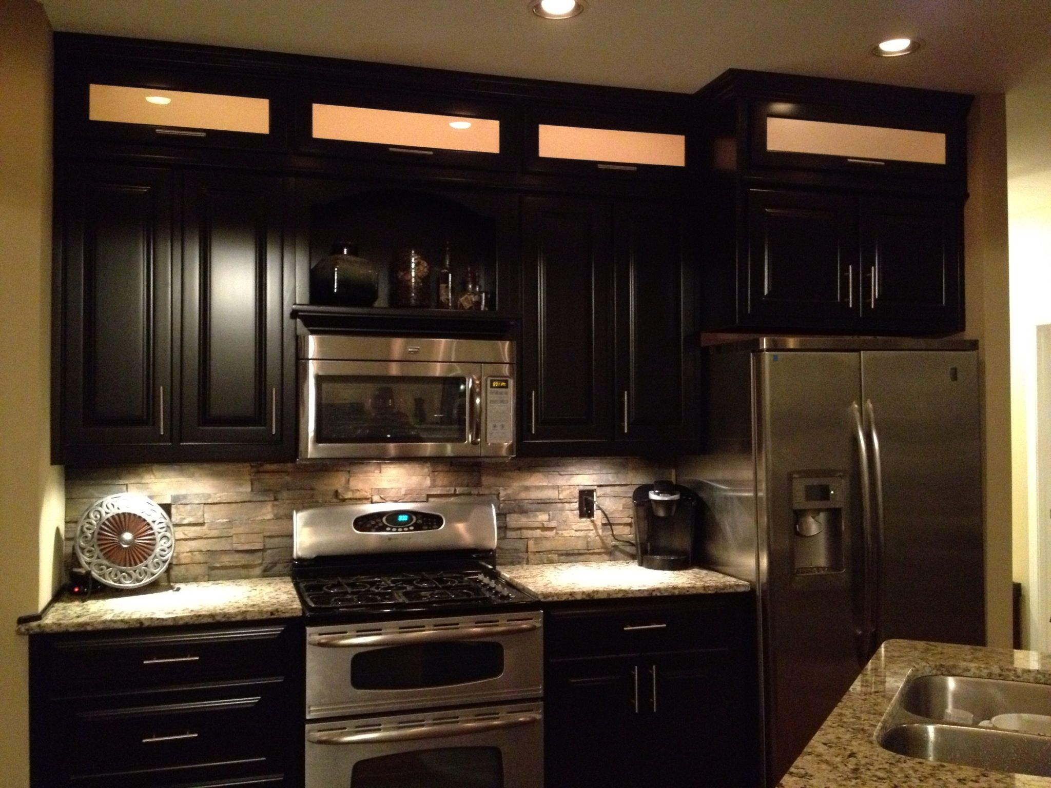 Espresso Cabinets Light Granite Stacked Rock Backsplash With In Cabinet And Under Cabinet Lighting Stone Backsplash Backsplash Brick Backsplash