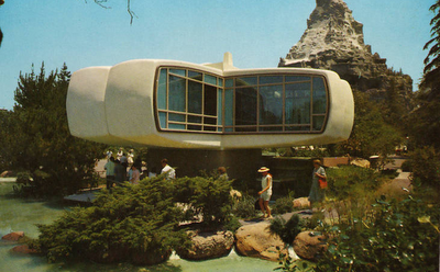 Disneyland had a walk-through attraction in Tomorrowland called the Monsanto House of the Future  from 1957 to 1967. It was a fiberglass structure, built to portray a home in the future year 1986.