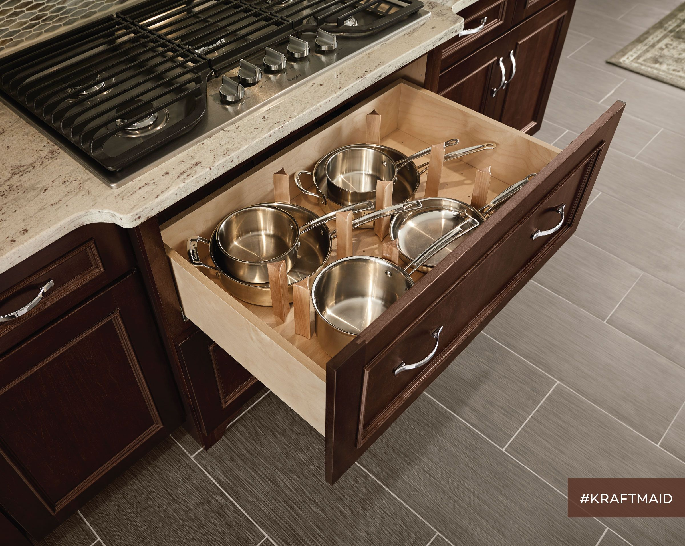 The scoop top drawer fits under the cooktop and provides Organizing kitchen cabinets and drawers