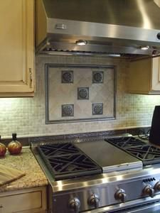 Framed arched kitchen niche behind cooktop with stacked glass tile ...