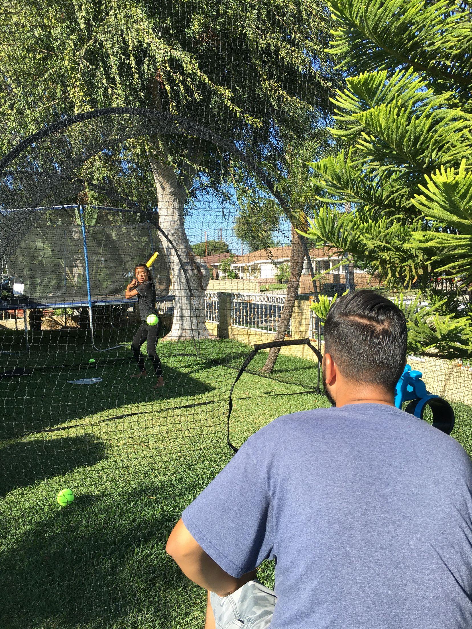 Baseball practice with pitching machine rental batting