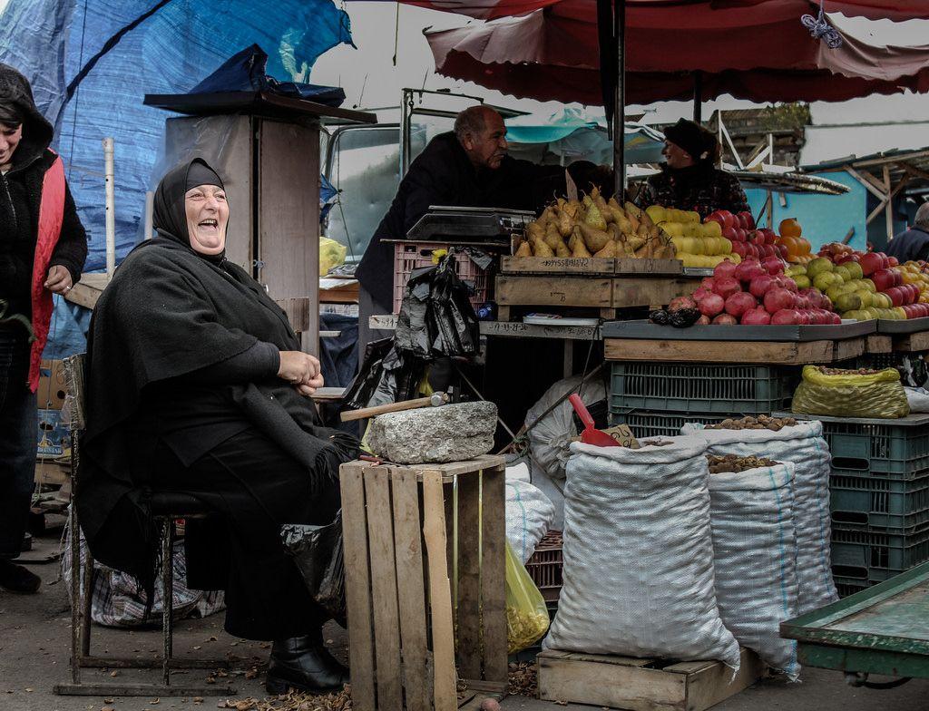 Nun Cracking Nuts at Tbilisi Market