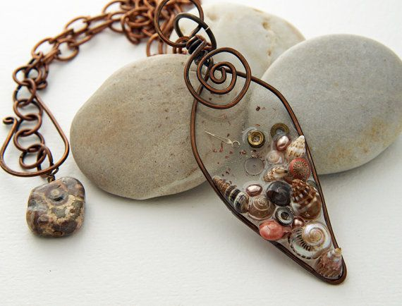 Wire frame with shells in resin necklace by