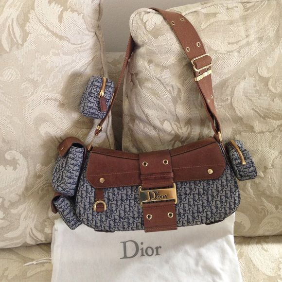 % Street Chic Columbus Ave Bag One of the popular bags of Christian Dior!absolutely in pristine condition as I have only used this a couple of times since purchased in the early 2000's-yes its vintage!it comes with the complete 4 baby bags.NO stain,NO rips, or any defect.pls see last photo on the only flaw which is only on the hardware and this is a NORMAL wear on any vintage,authentic item Dior Bags