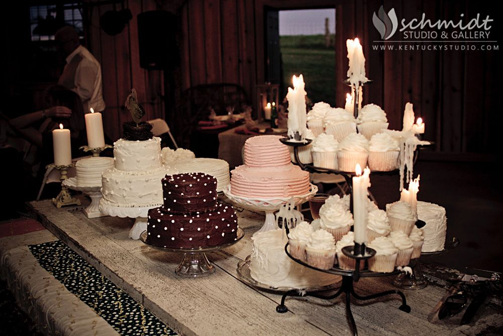 """Beautiful dessert table instead of a big """"cake"""".  The table is actually the door from the bride's grandmother's old home."""