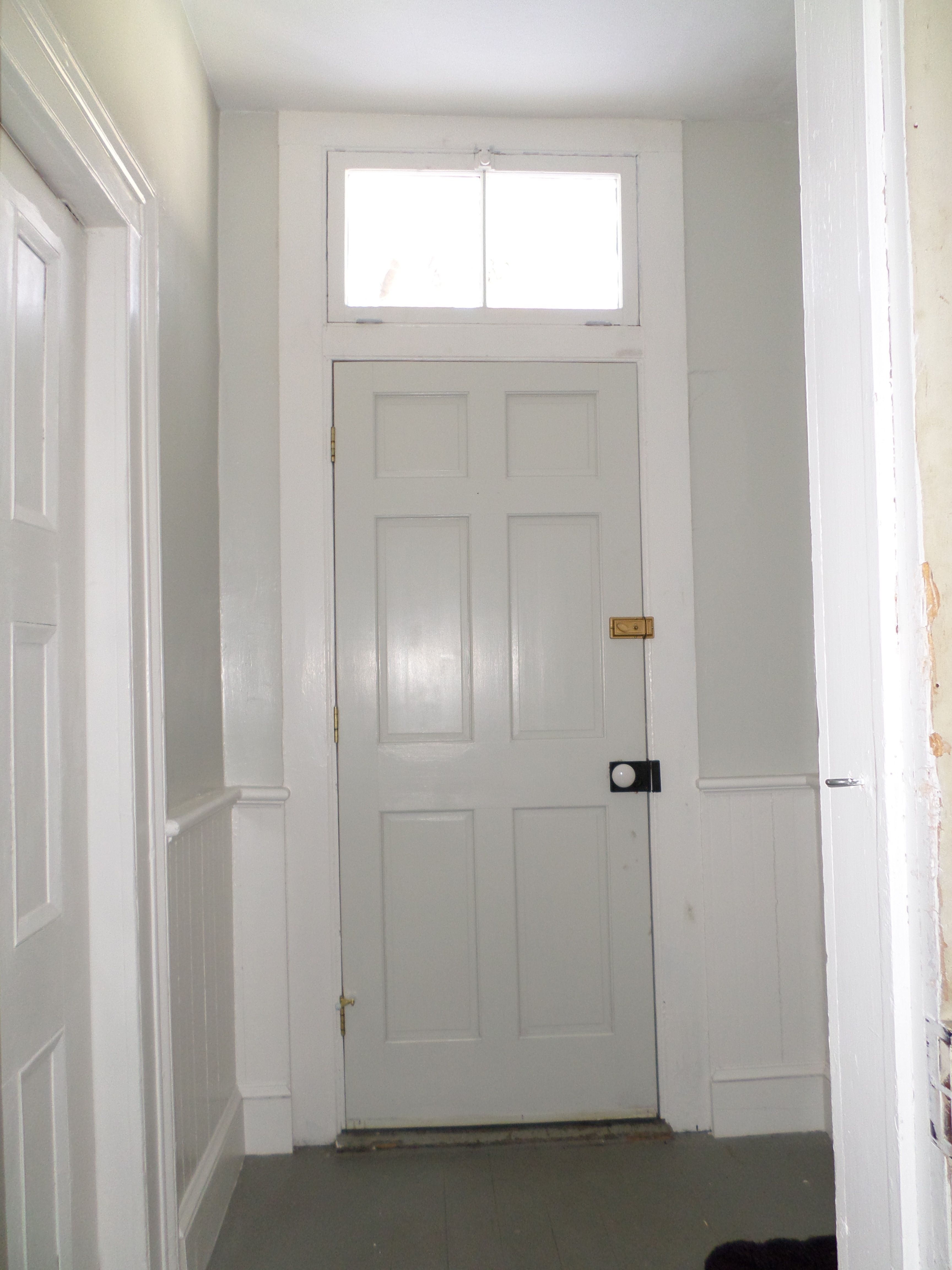 Back door and walls painted benjamin moore moonshine benjamin moore dove white on trim and wainscot rim lock in black with white porcelain knob from house