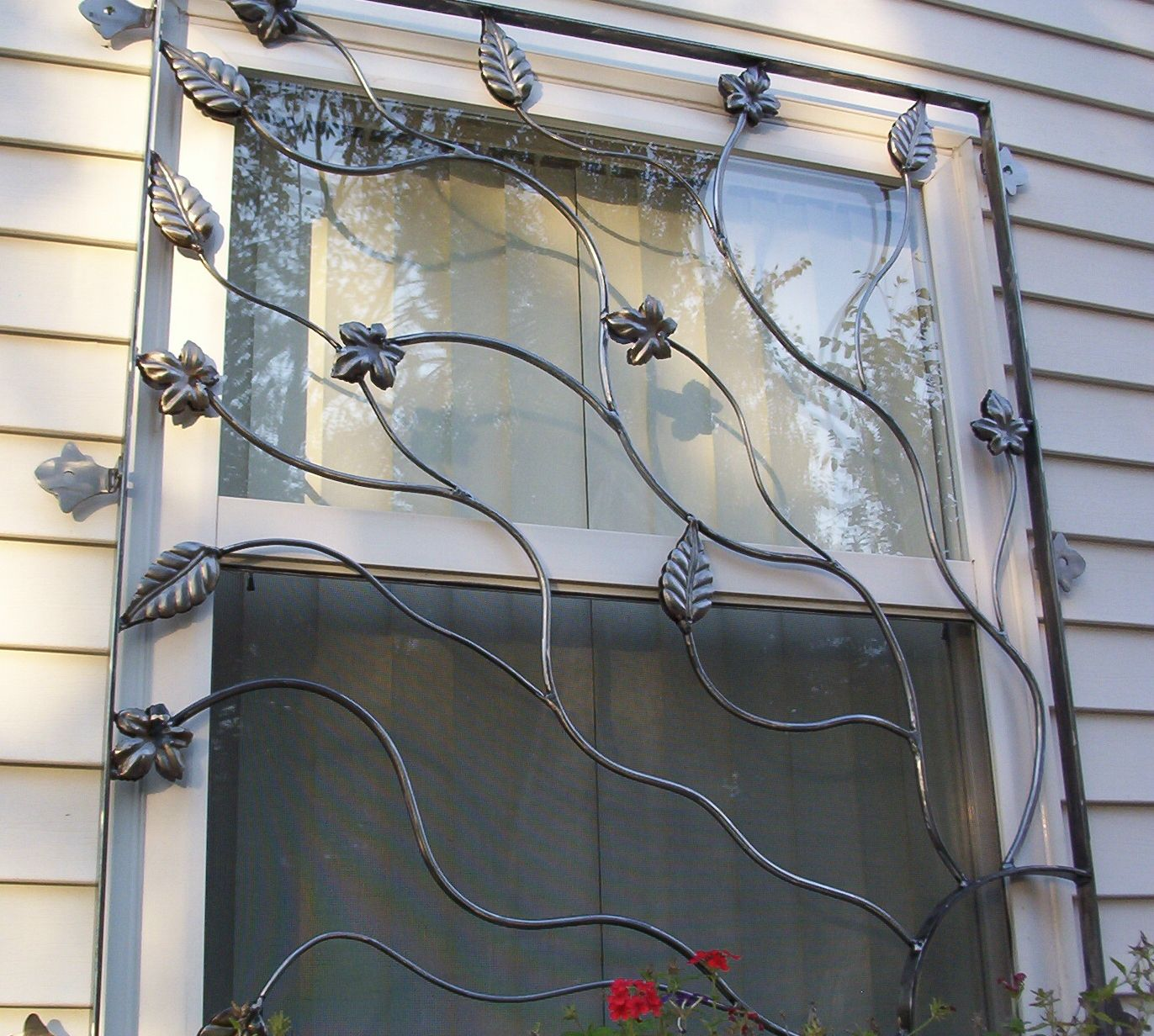 Cast iron security bars for window leaves and vines