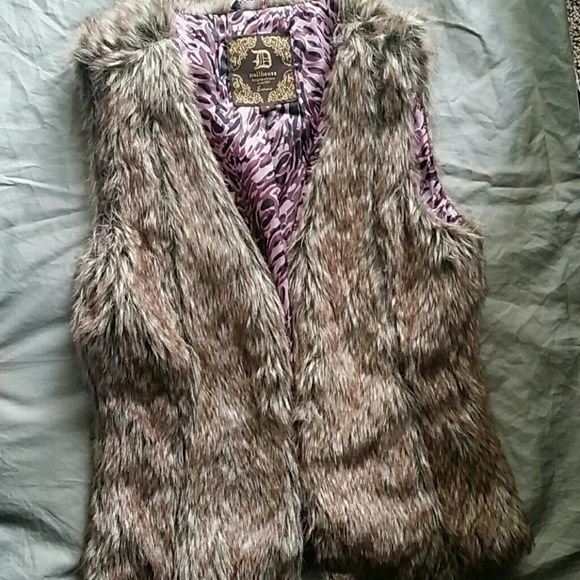 Faux fur fashion vest This stylish vest is a very cute accessory to ad to a pair of jeans and a tee. Great condition hasn't been worn much. Dollhouse Jackets & Coats Vests