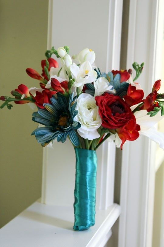this with calla lilies and roses but this size with a dark blue ribbon on the bottom or red or alternating for the girls