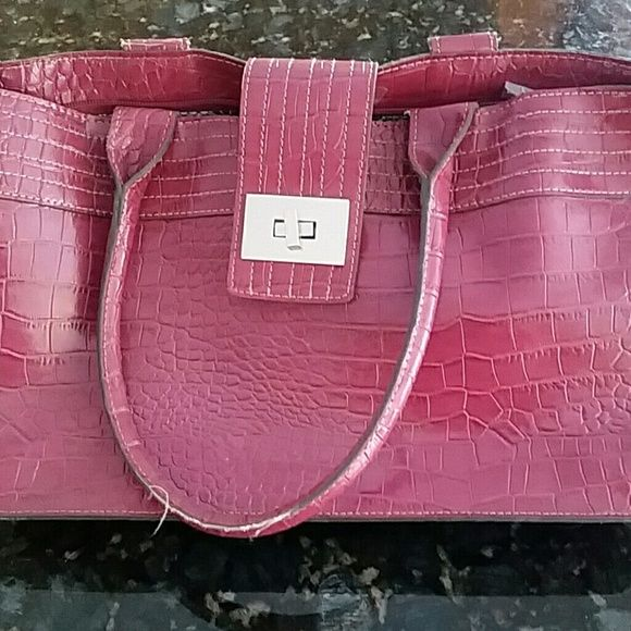 Mondani pink handbag or purse Pink used purse. Little or no sign of being used. 8 inches tall and 12 inches long, and 5 inches wide. mondani Bags Totes