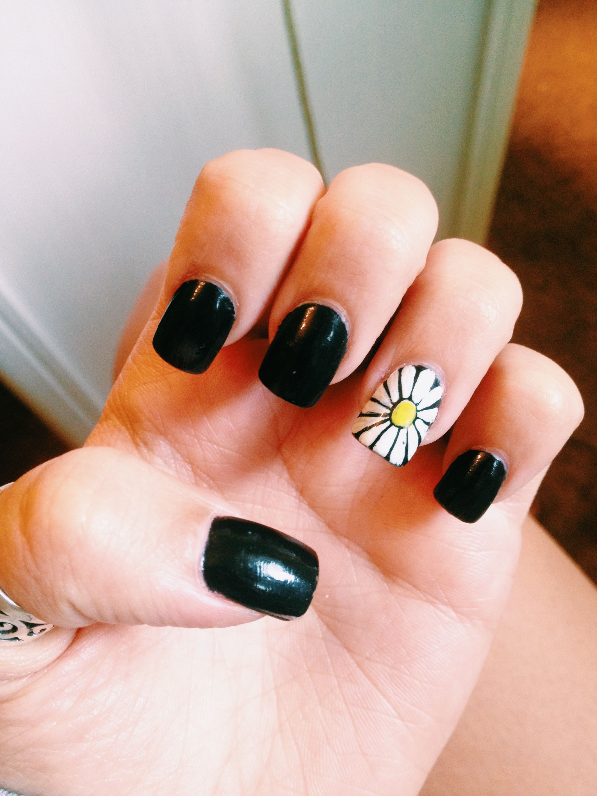 Acrylic nails painted black with a vintage white and yellow daisy ...
