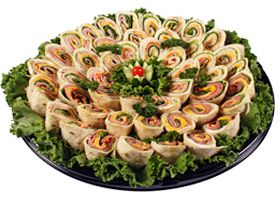 Catering idea: Jason's Deli (pinwheel sandwiches, fruit & cheese platters, pasta entrees, salads, snacks. Vegetarian-friendly.) http://www.jasonsdeli.com/sites/default/files/menus/jasons_deli_catering_03.pdf