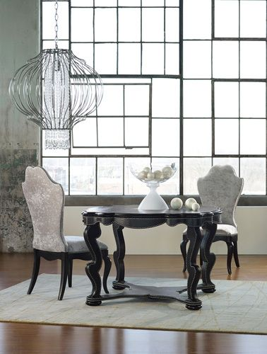 Our Bohemian Black Croc Dining Table is all drama with its wavy
