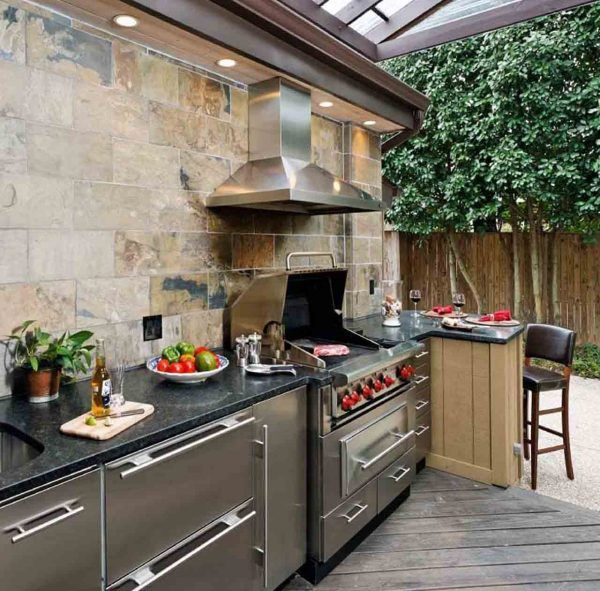 Incredible Guy Fieri Home Outdoor Kitchen Layout With Travertine Subway Wall Tile And Stain Covered Outdoor Kitchens Outdoor Kitchen Outdoor Kitchen Appliances