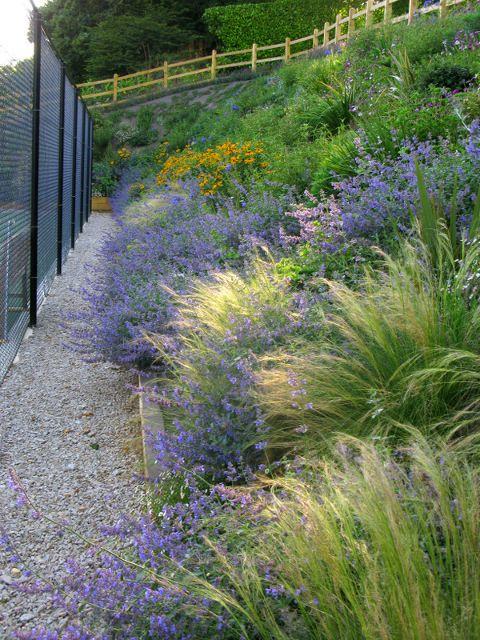 Garden Design By Cornwall Designer Based In Falmouth Tennis Court Landscaping Sloped Garden Hillside Landscaping Landscape Design