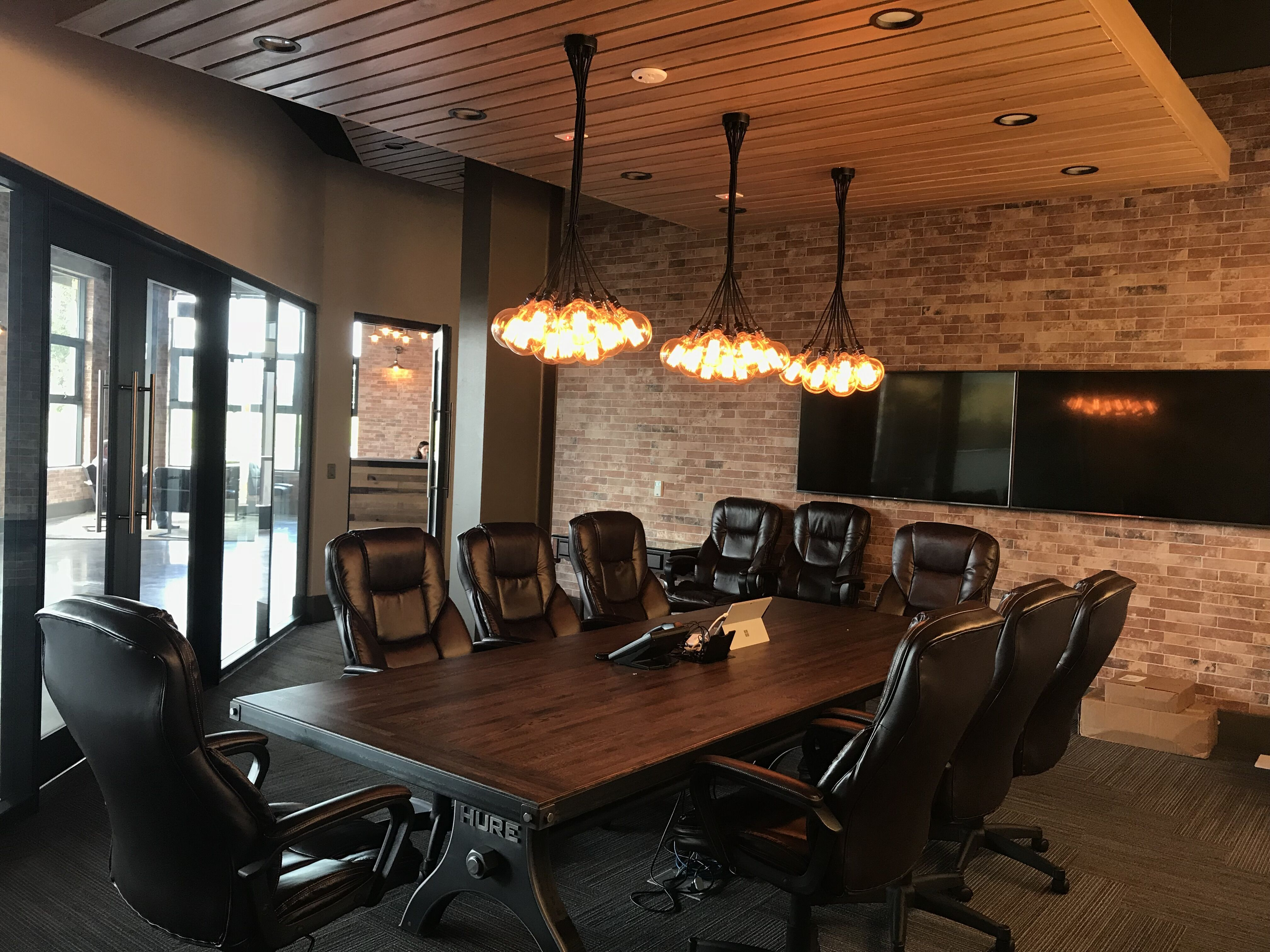 Modern Boardroom With Edison Lighting From Fireflylightingca, Rustic Yet Modern
