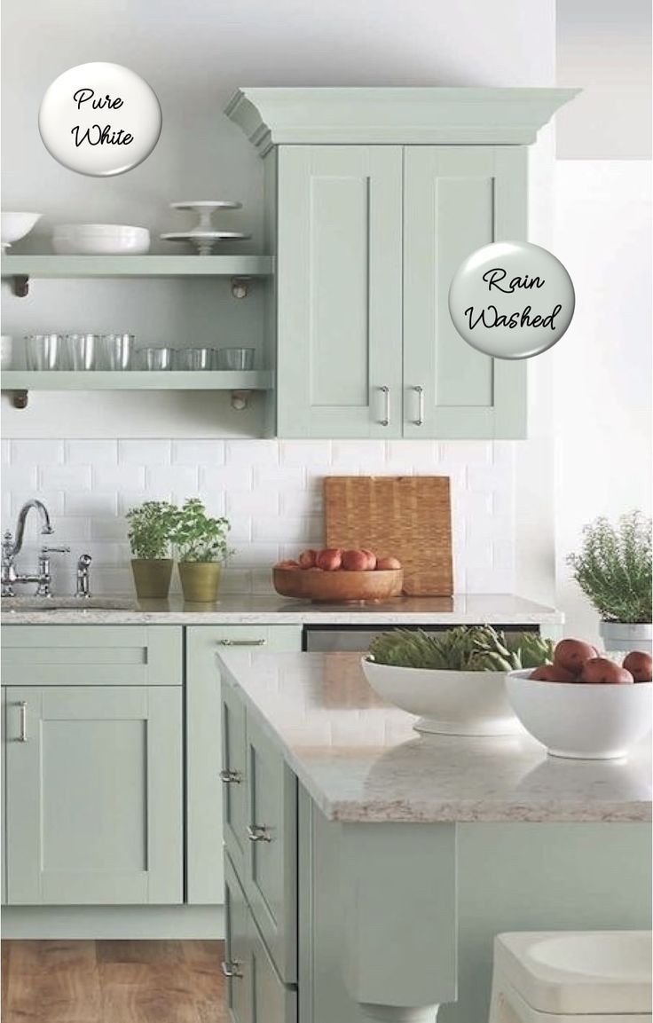 Two-toned painted cabinets in the kitchen are a hot trend that is here to stay! Here are some timeless paint color combos to consider for your kitchen to break up an all white kitchen. White and pale green kitchen cabinets. #cabinetpaintcolors #paintcolorideas #kitchenpaintcolor #cabinetcolors #coloredcabinets #twotonedcabinets #porchdaydreamer #paintcombosa