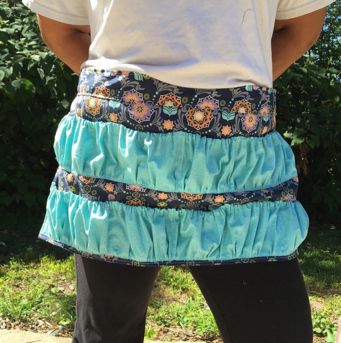 A personal favorite from my Etsy shop https://www.etsy.com/listing/243992055/gathering-egggarden-veggies-apron