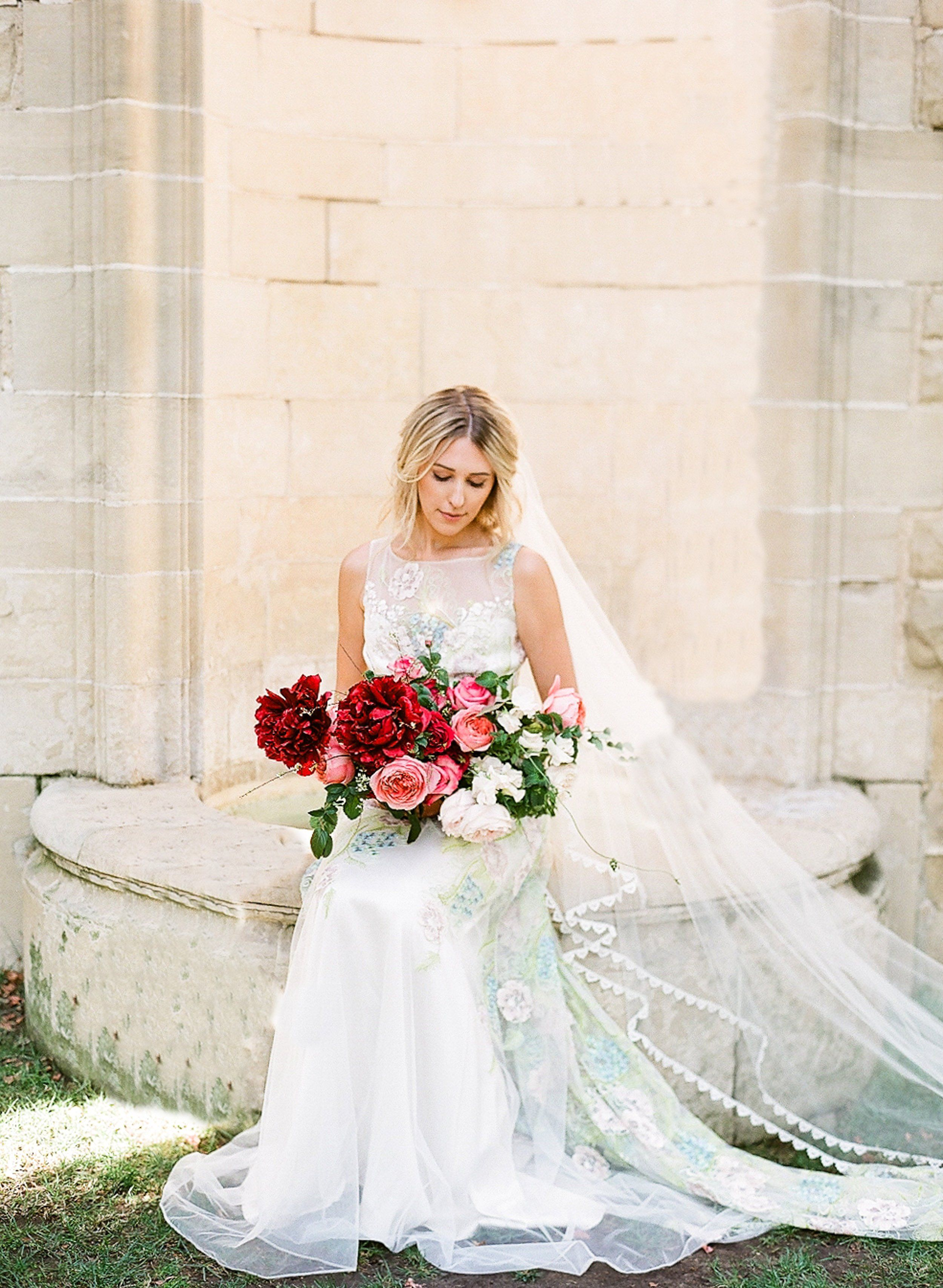 Claire Pettibone Maia couture wedding dress with colorful