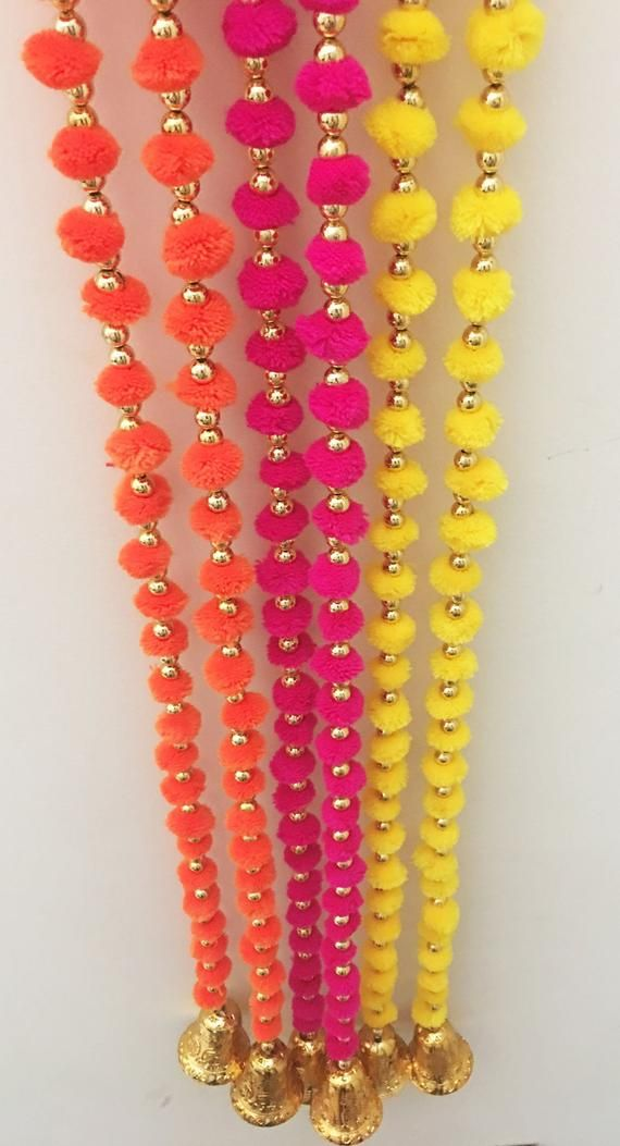 Pack of 6 Wool Pom Pom Garlands with Bell, Party backdrop, Photo Prop, Diwali Decorations, Indian wedding decor, Mehndi, Restaurant Decor  is part of Diwali decorations - Strings for Party Decor, Home, Shop or Restaurant Decor, Festive Decor, Indian Wedding Decor, Diwali Decor  These colorful garlands are great for indoor as well as outdoor decoration for parties, festivals or any special occasion  Assorted Color Pack of Total 6 Garlands  2 Yellow, 2 Orange, 2 Magenta Size Each Garland measures 60 inches (5 feet) approximately in length
