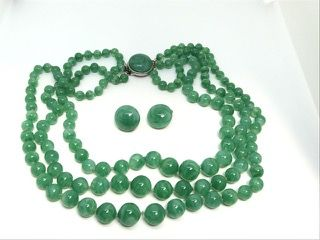 VINTAGE MADE IN FRANCE DEPOSE THREE STRAND POURED JADE COLORED GLASS NECKLACE WITH MATCHING CLIP ON EARRINGS. THE BEADS ARE INDIVIDUALLY KNOTTED WITH THE NECKLACE MEASURING 17 INCHES IN LENGTH.