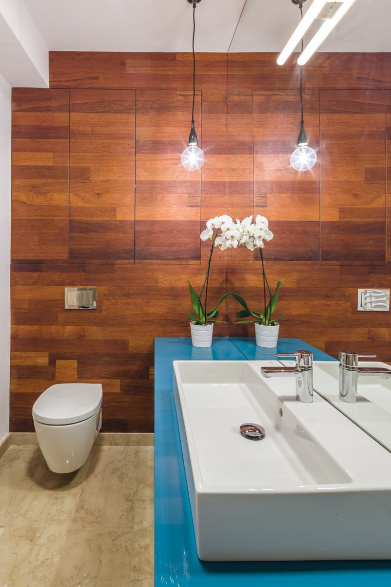 this bathroom has a wooden feature wall that hides storage rh pinterest com
