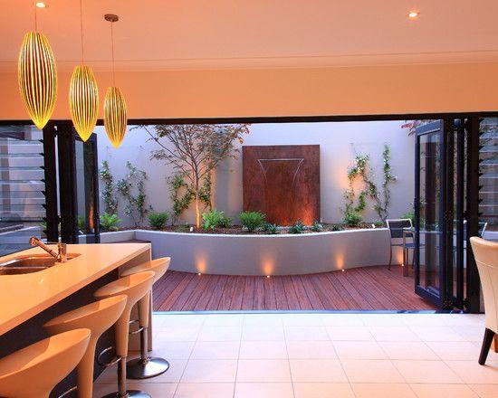 moderne terrasse gestaltungsideen wasserspiel japanisch sitzbank kissen - Moderne Dachterrasse Unterhaltungsmoglichkeiten
