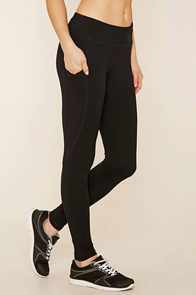 A Pair Of Long Yoga Pants With Mesh Side Pockets A Hidden