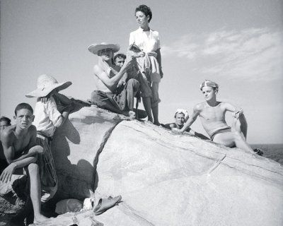 Beaton photographed a sunbathing Truman Capote with the writer Jane Bowles, standing, on a 1949 trip to Morocco.