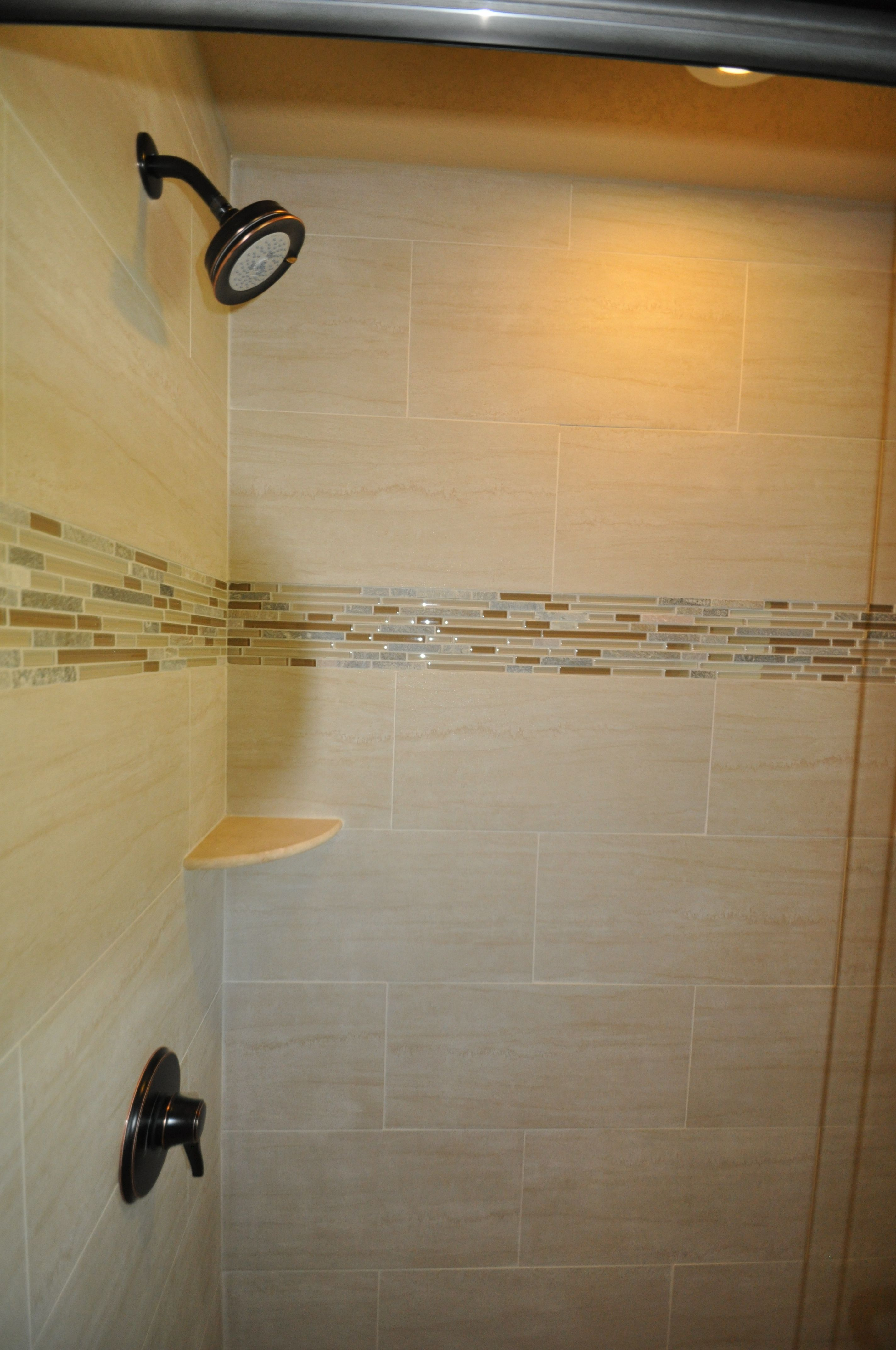 Cheaper than using fancy tiles on the whole shower, and adds a nice ...