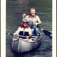 """Ohio University Libraries, Voinovich Collections. """"George and Janet Voinovich canoeing, ca. 1990s."""" :: Ohio University Archives"""
