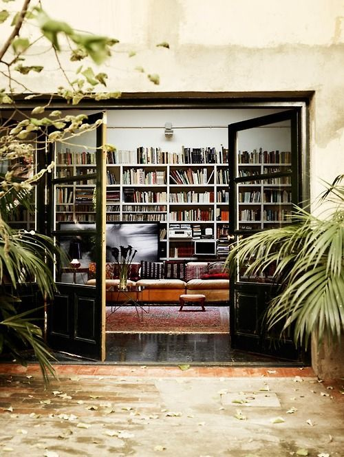 Black doors and bookshelves.