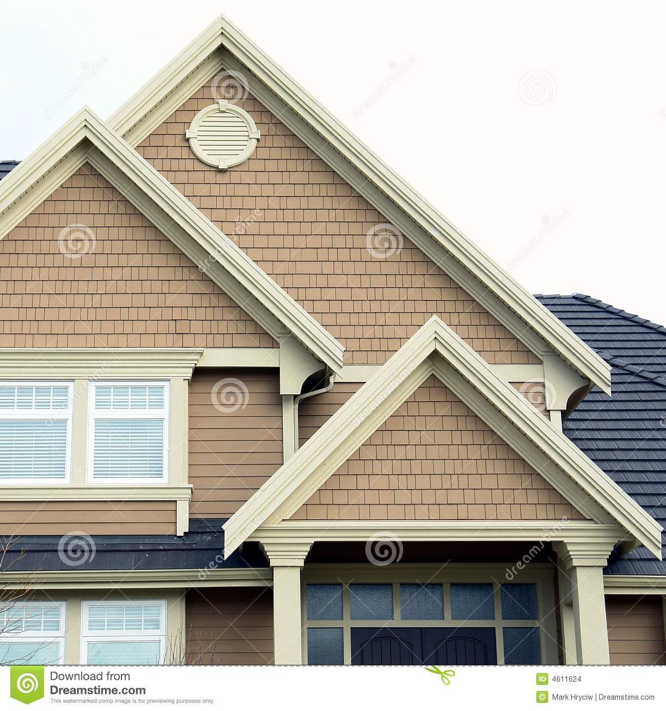 Gable roof within gable designs home house roof siding peaks stock images image 4611624 for Exterior house peak decorations