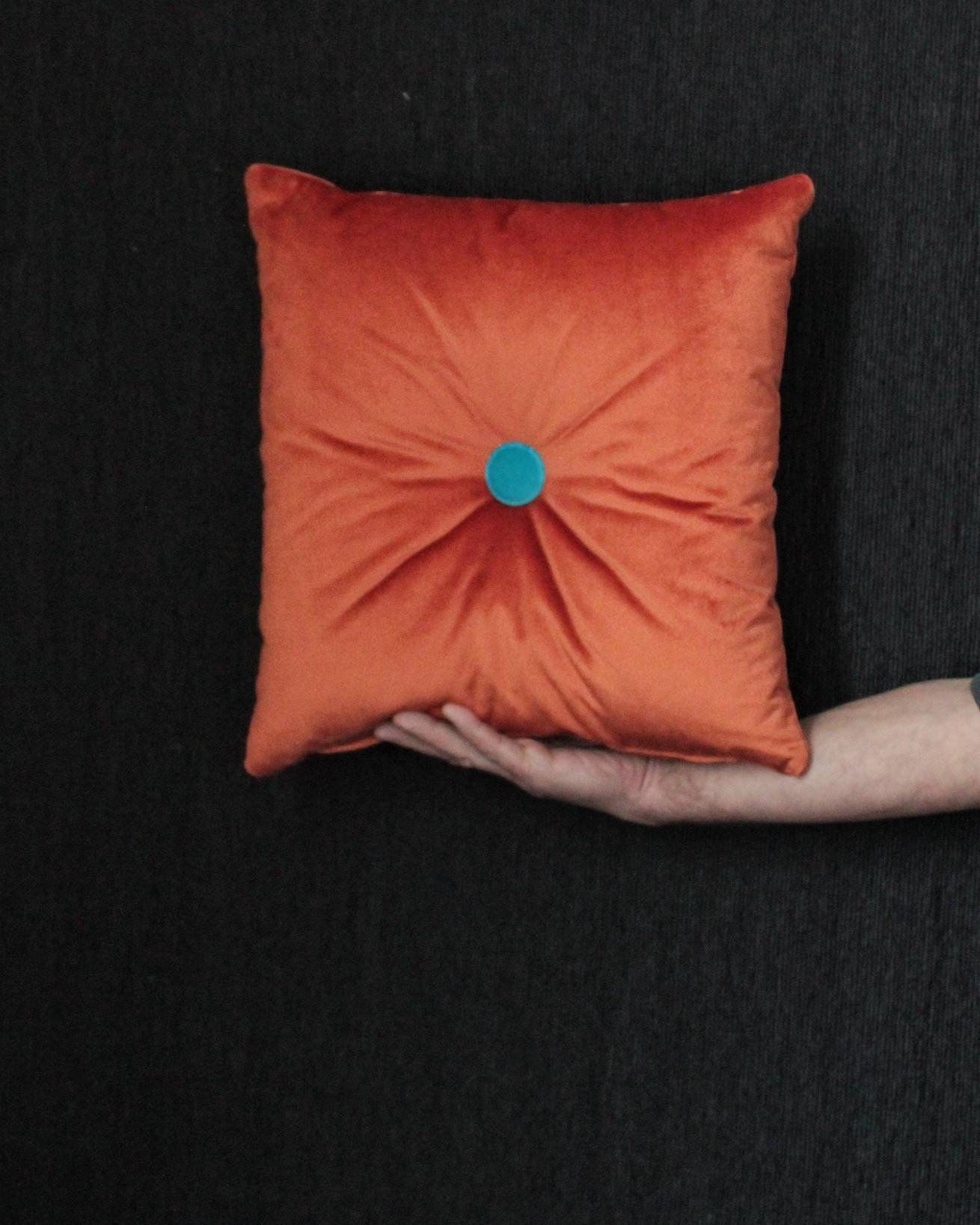 Orange velvet pillow. Sophisticated