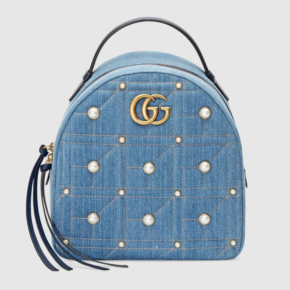 641daf4b0ef0 Shop the GG Marmont denim backpack by Gucci. The GG Marmont backpack has a softly  structured shape and Double G hardware, inspired by an archival design.