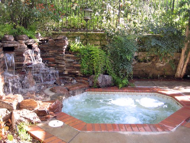 Backyard in-ground hot tub... just cause.   Hot tub ...