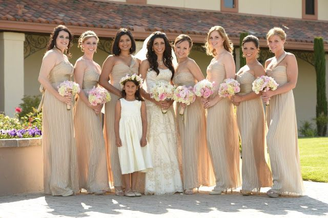 these light gold bridesmaid dresses are incredible! and such gorgeous flowers!