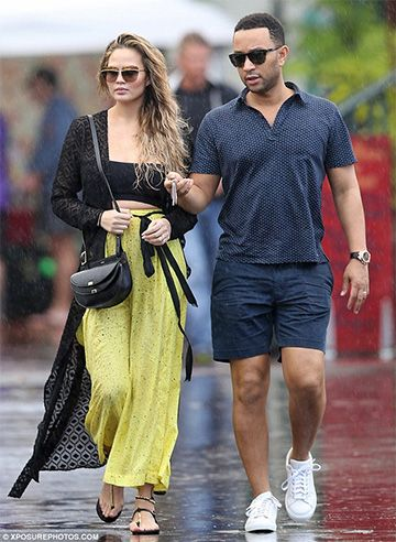 Chrissy Teigen and John Legend on vacation in Hawaii, December 22, 2015. Chrissy´s wearing Dior Metallic Sunglasses http://bit.ly/1UoiTHd, a Nookie Jagger Sheer Wrap Maxi http://bit.ly/1Rin8oe, a Chloé Georgia Mini Leather Shoulder Bag http://bit.ly/1ms6WG5, Proenza Schouler Printed Wide-Leg Pants http://bit.ly/1R4Bl9N and Ancient Greek Sandals Chrysso beaded leather sandals http://bit.ly/1IKCZuN. #style #celebstyle