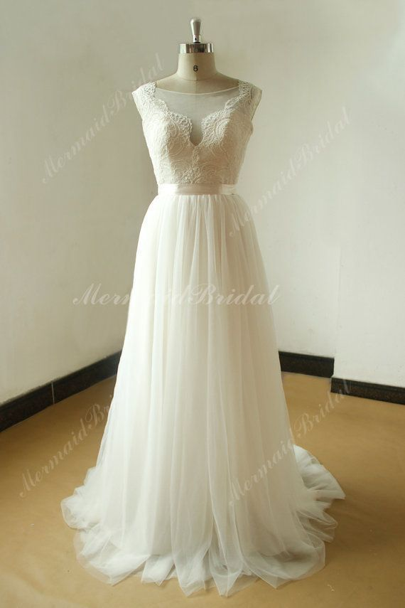 Open back deep V neckline a line tulle lace wedding dress Fabric: Tulle, Lace, silk like satin Embellishment : lace Silhouette: A line Neckline: