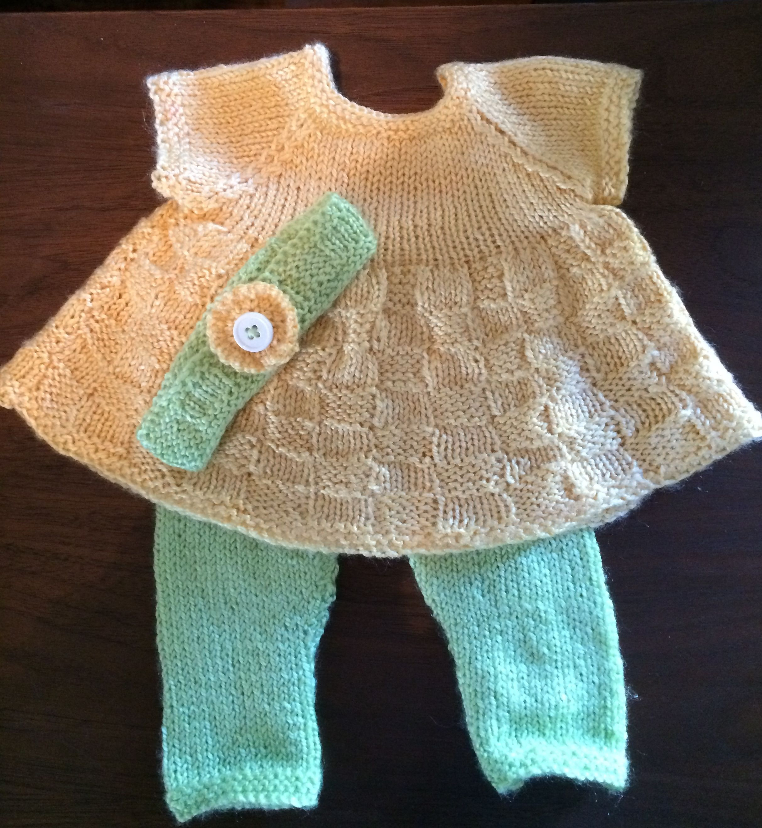 "Easter design for 14"" baby doll. Easy to knit, back fastening. Dress is done in one piece from the bottom up using straight needles.  http://www.ravelry.com/patterns/library/basket-weave-dress-leggings-headband-for-14-doll"