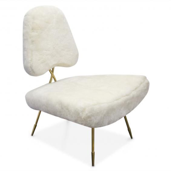 A chair should look as good from the back as the front. Super-minimalist and sculptural, our Maxime Chair is a seating masterpiece. The brass metal base and crisscross back add a dose of hard glamour, while the rich fabrics and soft curves nod to Mid-Century chic. Signature sabots on the legs add classic polish, making this the perfect lounge chair to add bold punctuation to any room.