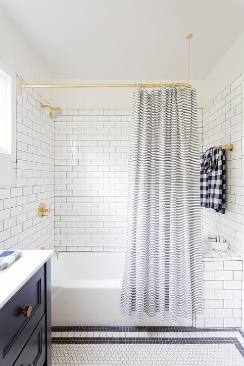 Beautifully Designed White And Blue Boys Bathroom Is Fitted With A Polished Brass Curved Shower