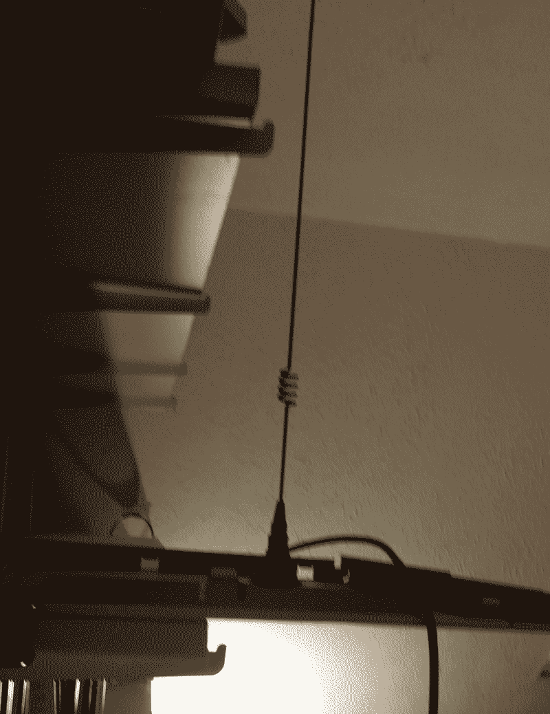Another view of my 2m antenna resting on a panel from a PC clamped on a bookshelf.