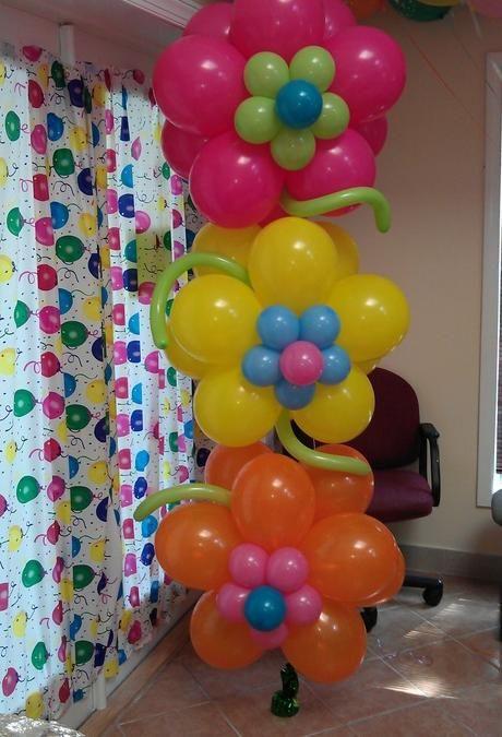 Flores hechas con globos en fiesta infantil lluvia de - Decorar con globos ...