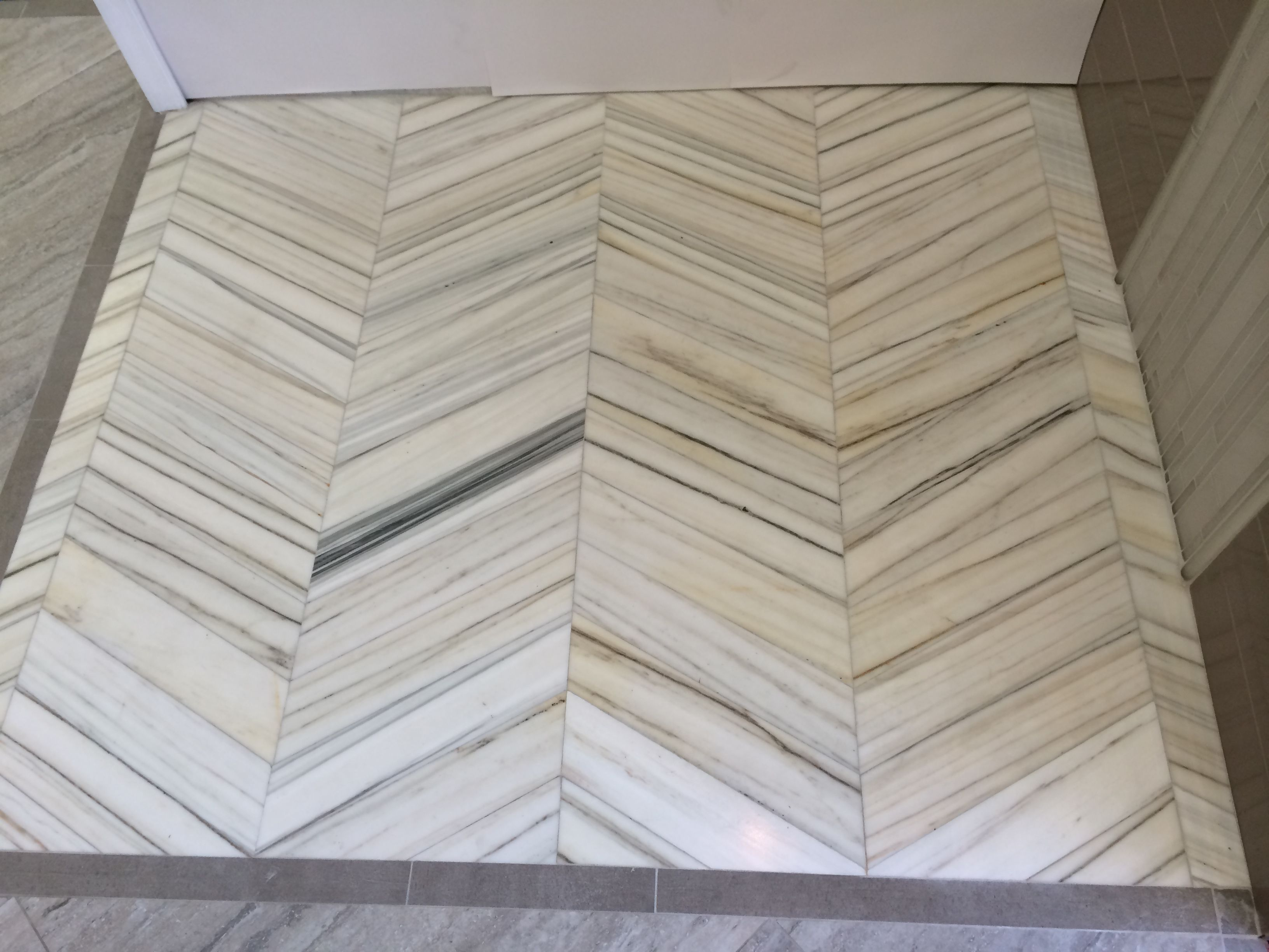Helsinki Marble installation in our Chantilly, VA Showroom.  -Architectural Ceramics