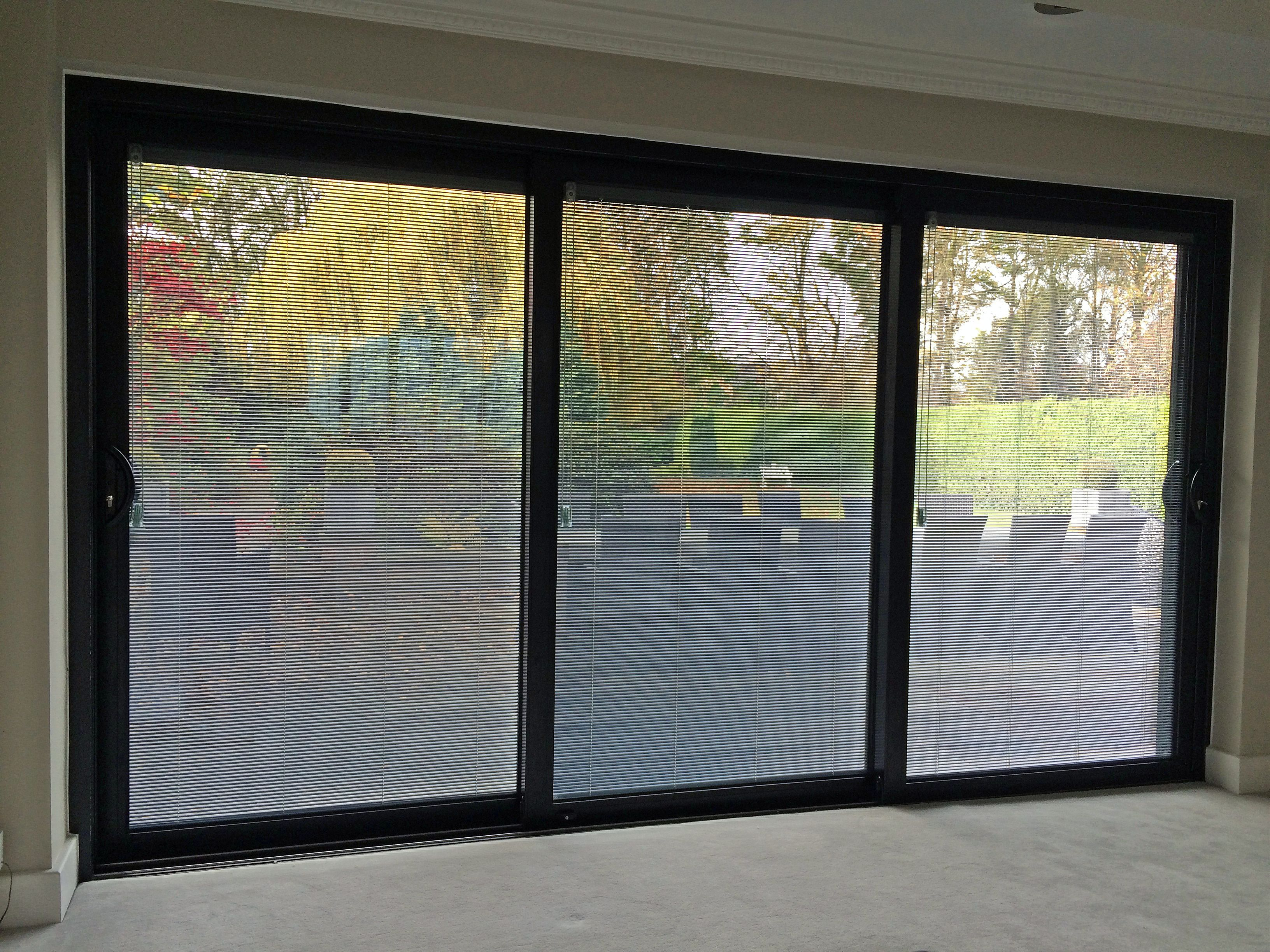 A Smart Visoglide Plus Triple Track Sliding Door Complete With