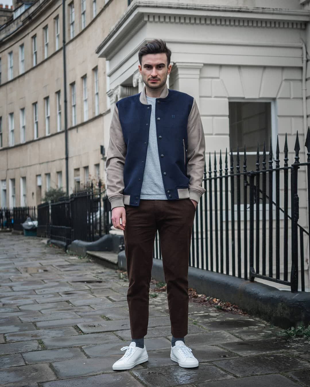 Casual navy and beige bomber jacket for men, paired with a