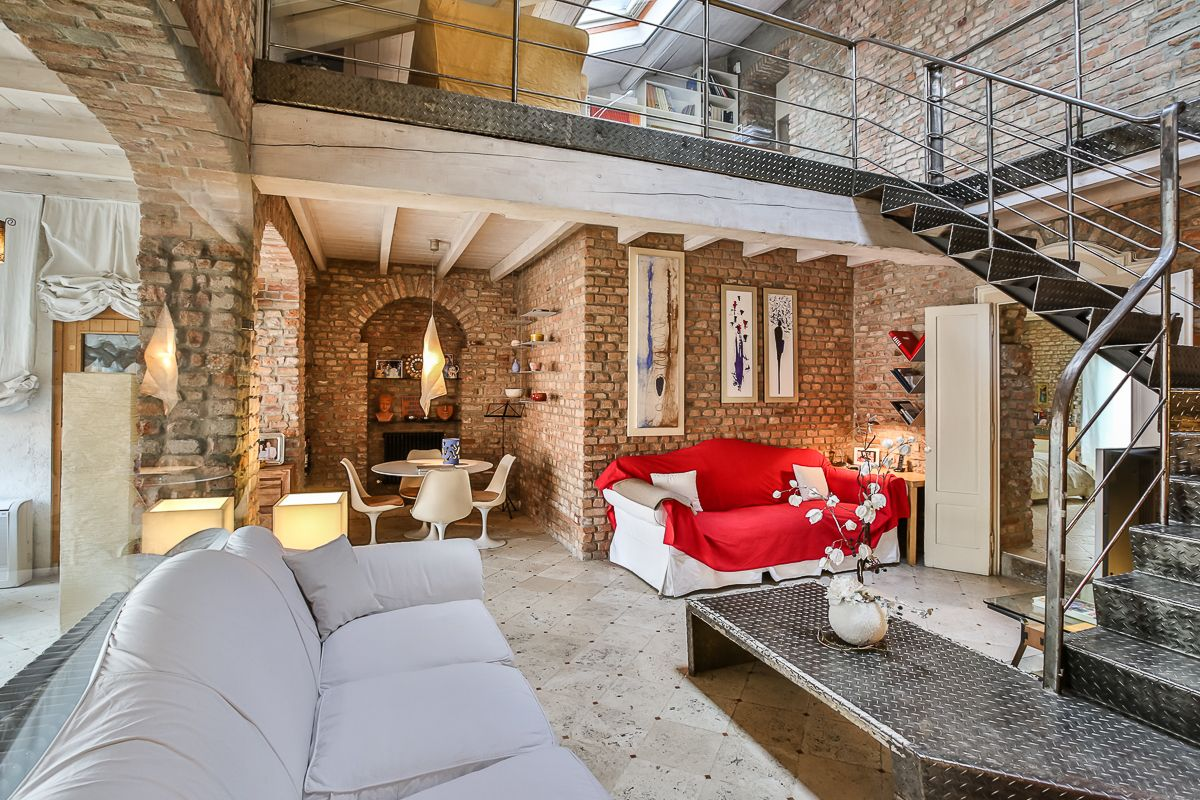 Contemporary Sohostyle Loft With Exposed Bricks And Wood Beams In - Contemporary soho loft with exposed brick and wood beams