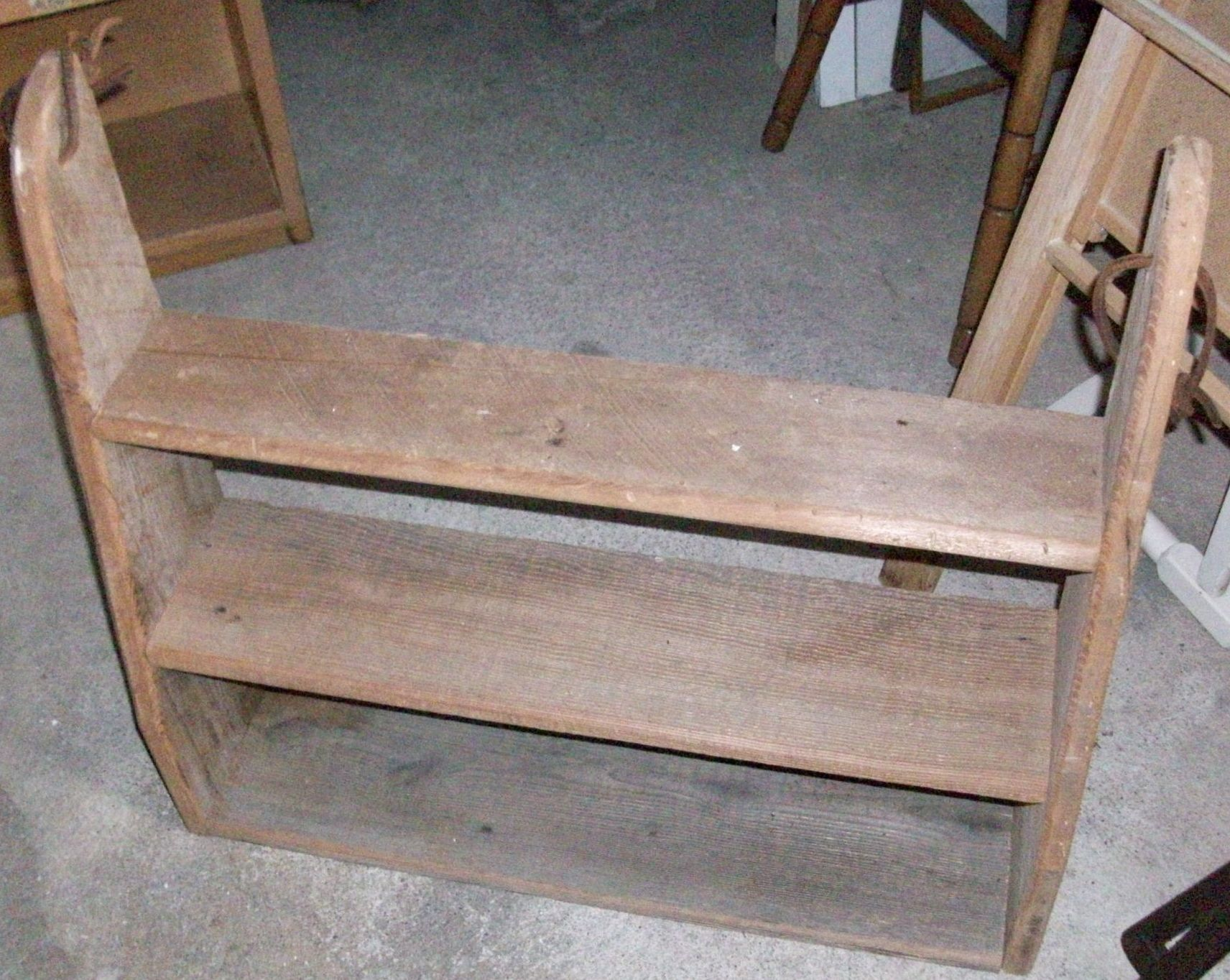 This primitive or western look wall shelf is hung by two rawhide loops.  Now at Black Diamond Antique and Collectible Co-op.  SOLD