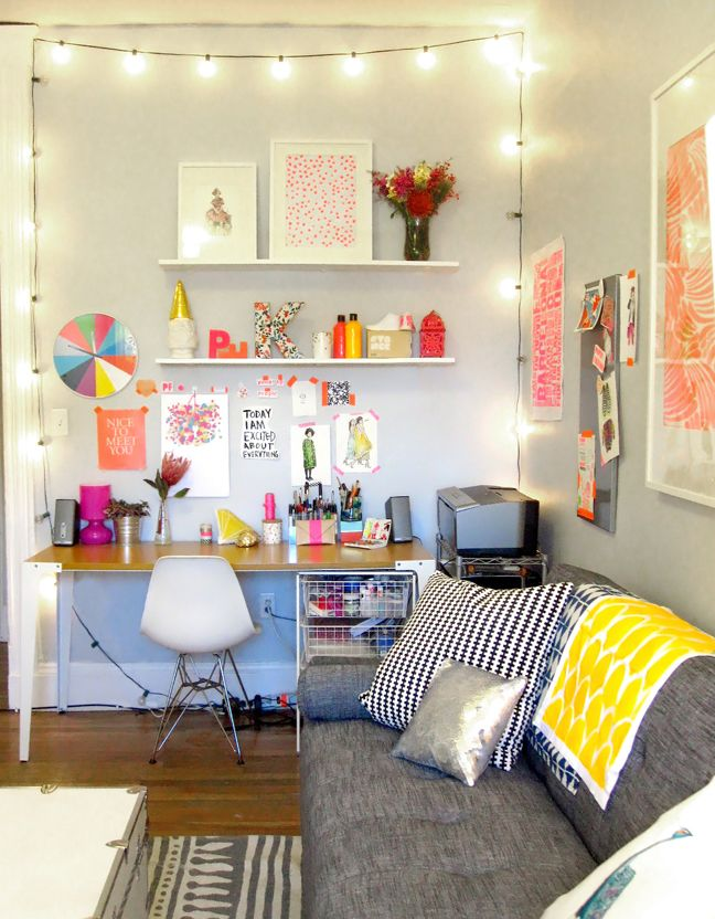 A cheerful office. Gray couch.